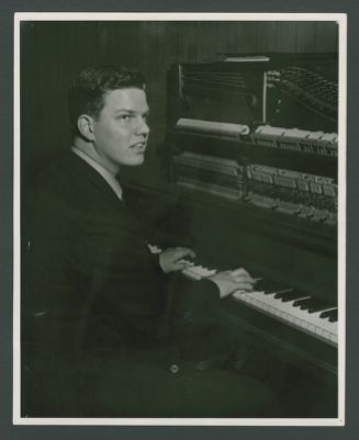 Publicity photograph of Peter Clute at piano