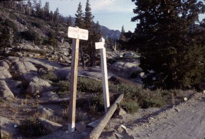 Donner Pass. Site #12 looking SW over site. Note lack of trees. Signs read Old Donner Summit Rd