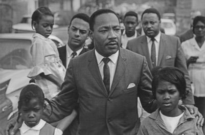 Eva Grace Lemon (7 years old), Martin Luther King Jr., Aretha Willis (7); background Andy Young, Hosea Williams, march to integrate schools,  Grenada, MS, 1966
