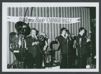 Photograph of Turk Murphy Jazz Band after playing Carnegie Hall NYC, Bill Carroll, Turk Murphy, Bill Armstrong, Bob Schulz, Jim Maihack and Ron Deeter at the New Orleans Room, Fairmont Hotel, last time Turk Murphy played trombone, he passed away later that year (1987)