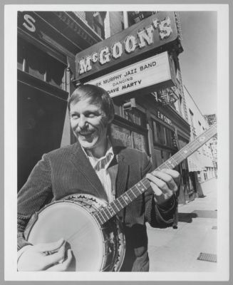 Carl Lunsford, banjo, in front of Earthquake McGoon's, 630 Clay Street