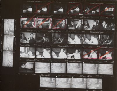 [Man in conference room at 860 Broadway; James Curley and unidentified man at restaurant; Ronnie Cutrone and Michael Heizer in conference room at 860 Broadway; Union Square]