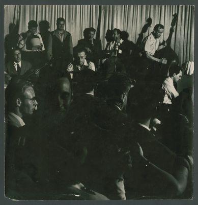Yerba Buena Jazz Band at Hambone Kelly's: Harry Mordecai, Turk Murphy (on jug) Lu Watters, Bill Dart, Bob Scobey, Bob Helm, Dick Lammi and Wally Rose with crowd