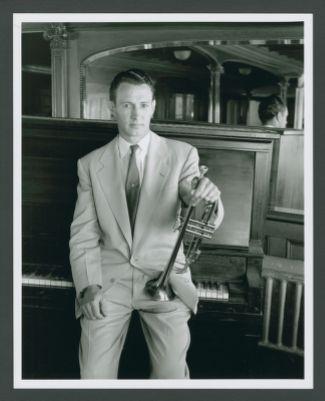 Bob Scobey portrait on ferryboat, leaning on piano
