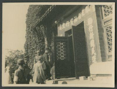 Wang Jingwei enters a building