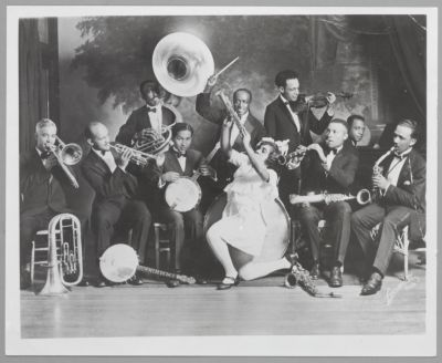 The Sid Le Protti Band, San Francisco, c. 1923 (L to R: Roy Tayborn, trombone/baritone euphonium; Elliot Worth (?), trumpet; John Terrell, tuba; unknown on banjo; Harry Pierson, drums; Lottie Brown, singer/dancer; unknown on violin; George Heard, clarinet; Sid Le Protti, piano/leader; Norris Hester, alto sax