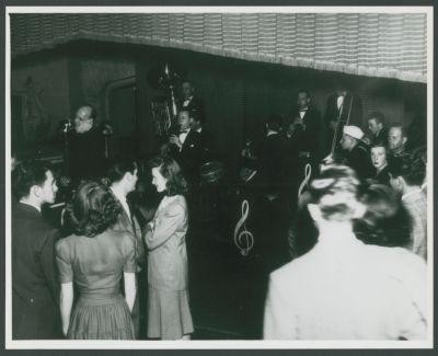 War time Yerba Buena Jazz Band at Dawn Club with crowd: Clancy Hayes, Bill Coonley, Ellis Horne, Bob Helm and Bill Bardin