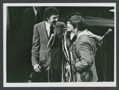 Bob Schulz, Pat Yankee, Turk Murphy, on stage