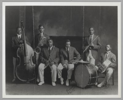 Sid Le Protti's So Different Jazz Band, San Francisco, circa 1915-18 (L to R: Clarence Williams, string bass; Reb Spikes, baritone sax; Adam 'Slocum' Mitchell, clarinet; Sid Le Protti, piano/leader; Gerald Wells, flute; (unidentified on drums)