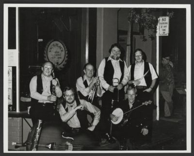 Golden State Jazz Band: Bill Napier, Mike Duffy, Ev Farey (leader),Bob Mielke, Carl Lunsford, Hal Smith and standing in the corner far right, Burt Bales