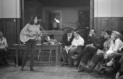 Joan Baez leads singing, annual Southern Christian Leadership Conference staff workshop Penn Center, Frogmore, SC, 1966