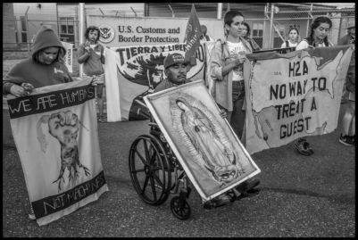 Farm workers and their supporters march to protest the H2-A guestworker program and the death of Honesto Silva