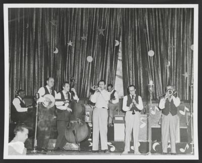 Bob Scobey Band on stage at San Quentin: Jessie Crump, Clancy Hayes, Hal McCormick, Bob Scobey, Fred Higuera, Bill Napier and Jack Buck